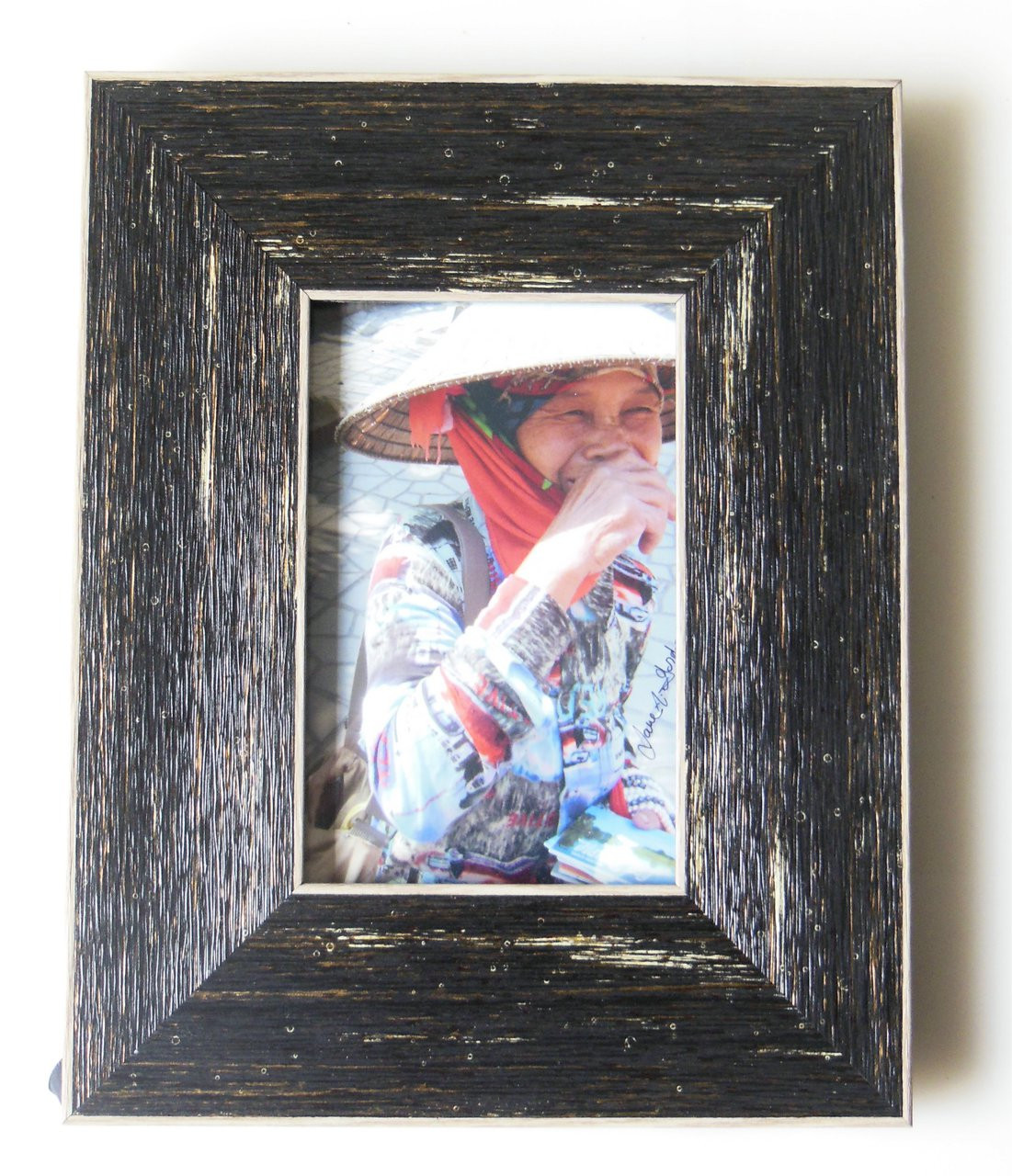 Laughing woman in Halong Bay, Vietnam.  Framed, signed photo.