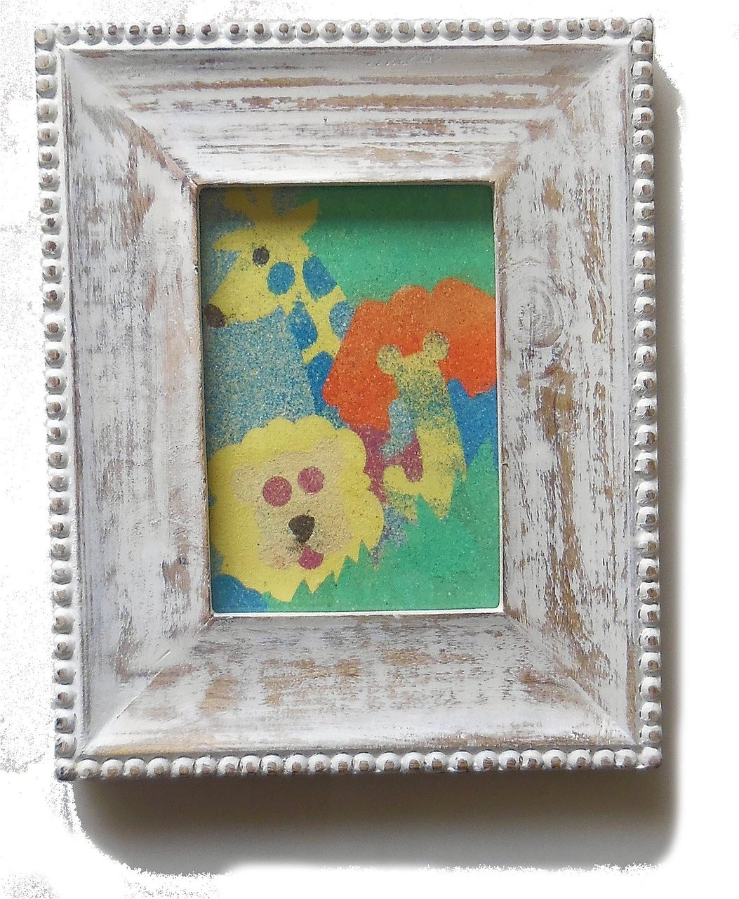 Children's colorful wild animals, sand art framed in wood.