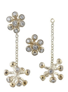 Starburst earrings from the Fireworks Jewelry Collection, can be made in just a drop, or as shown here with one of the other fireworks earrings as a stud.  Shown here separated and in silver with diamonds.