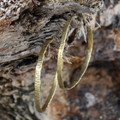 Medium sized brass textured hoop earrings with sterling silver posts