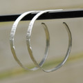 Medium sized silver textured hoop earrings with sterling silver posts