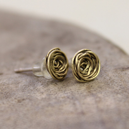 Textured and spun brass stud earrings with sterling silver posts