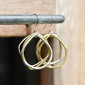 Small brass and silver wavy circle drop earrings with sterling silver posts