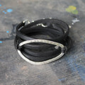 Thin black leather multi wrap bracelet with silver detail and toggle closure