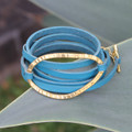Thin turquoise leather multi wrap bracelet with brass detail and toggle closure