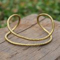 Textured and bent brass cuff bracelet forms perfectly to the wrist