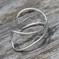 Textured and bent silver cuff bracelet forms perfectly to the wrist