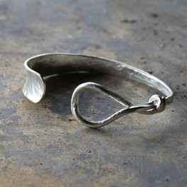 Silver cuff bracelet with twist detail