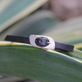 Thin black leather bracelet with silver closure