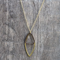 Gold oblong pendant on delicate chain