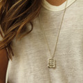 """Long necklace in silver features """"NO REGRETS"""" inspirational message"""