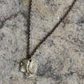 Organic shaped pendant in brass