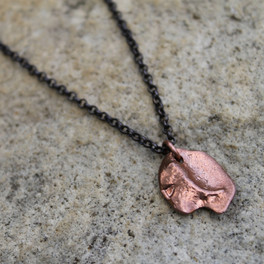 Organic shaped pendant in copper