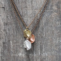 Organic shaped pendant in brass, silver and copper