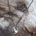 Organic shaped pendant in silver