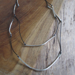 Black leather cord with silver detail