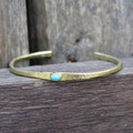 Brass thin cuff with turquoise inset stone