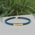 Teal leather bracelet with brass BALANCE detail