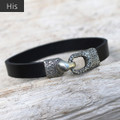 Silver bronze toggle closure on black leather bracelet