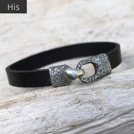 Silver bronze toggle closure on black leather bracelet