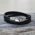 Silver bronze toggle closure on black leather wrap bracelet