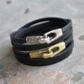 Silver bronze and brass toggle closures on leather wrap bracelets