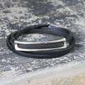 Silver bronze detailing on black leather wrap bracelet