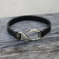 Silver bronze detail on black leather bracelet