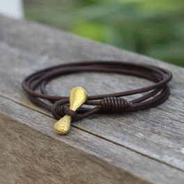 Brass toggle closure on chocolate brown multi wrap leather bracelet