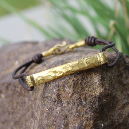 Textured brass detailing on chocolate brown leather bracelet