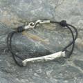 Textured silver detailing on black leather bracelet