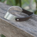 Curved silver with dark grey leather bracelet