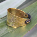 Textured antique brass bracelet with black leather