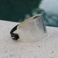 Textured silver bracelet with dark grey leather
