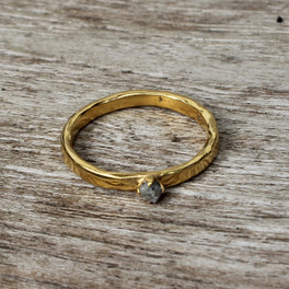 Polished gold plated sterling silver ring with raw diamond solitaire setting