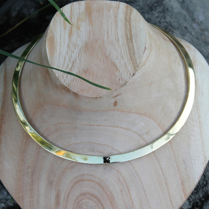 Polished brass collar necklace with black centre stone