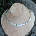 Polished silver collar necklace with black centre stone