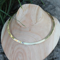 Polished brass collar necklace with white centre stone