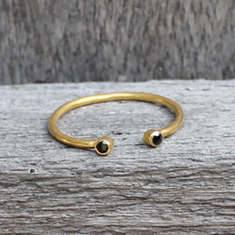 gold plated open ring with black stone