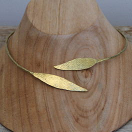 A feminine, nature inspired brass collar necklace