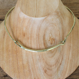 An industrial, modern brass collar necklace