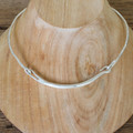 An industrial, modern silver collar necklace