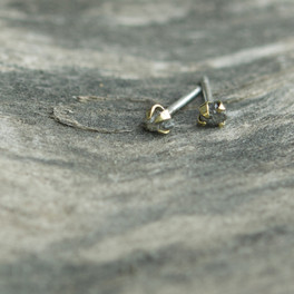 Raw diamond studs with oversized brass claws
