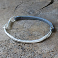 Silver modern bracelet with dark grey leather