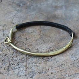 Brass modern bracelet with black leather