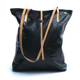 black leather tote bag with simple tab closure
