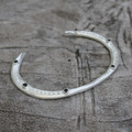 adjustable silver plated brass bracelet with black stone detail