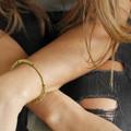 adjustable brass bracelet with black stone detail