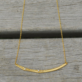 gold filled delicate chain bar necklace with white stone detailing