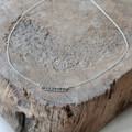 sterling silver delicate chain ID necklace with raw diamond detailing